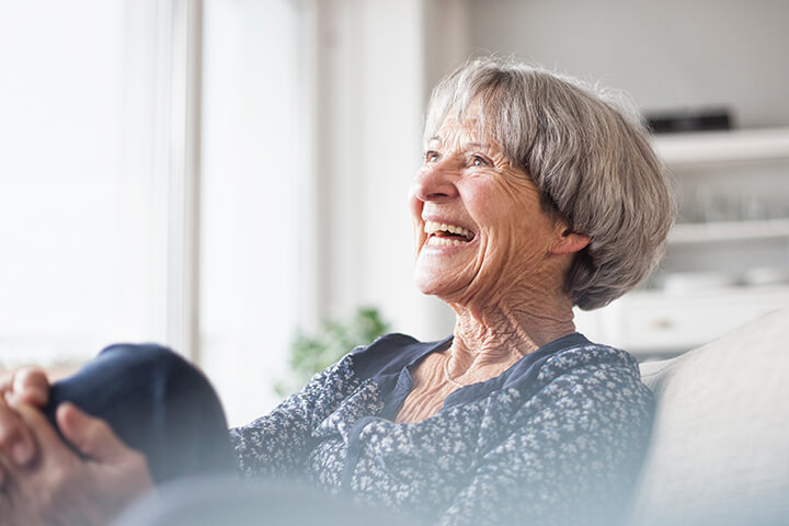 Elderly woman laughing at Life Care Gaynes Park Suites