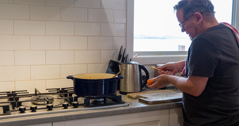 Gaynes Park Suites - Removing the burden campaign- single man cooking for himself